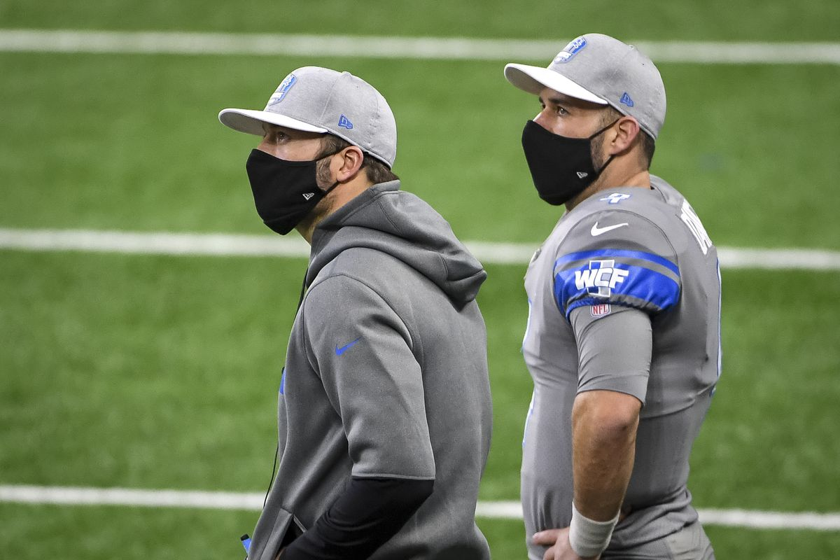 Matthew Stafford #9 of the Detroit Lions and Chase Daniel #4 of the Detroit Lions look on in the fourth quarter of the game against the Tampa Bay Buccaneers at Ford Field on December 26, 2020 in Detroit, Michigan.