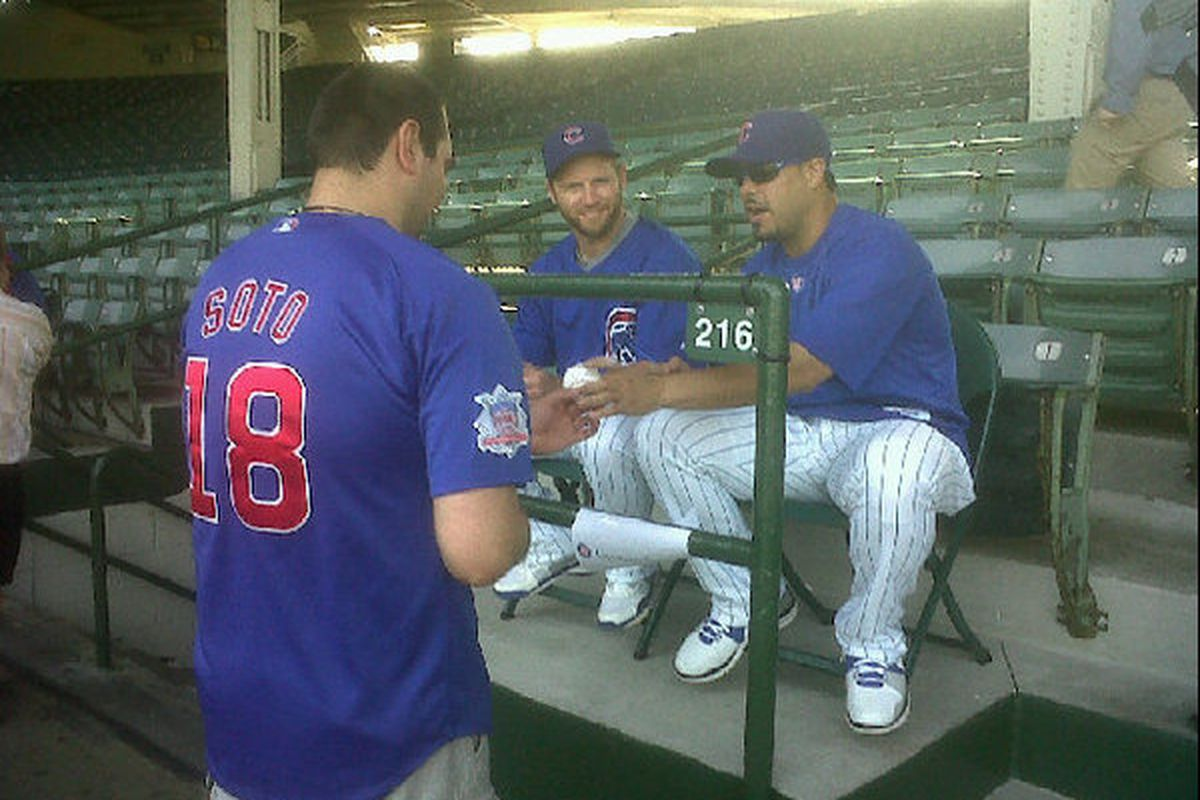 Fan in a Soto jersey meets the real Geovany. #Cubs catching duo pictured.