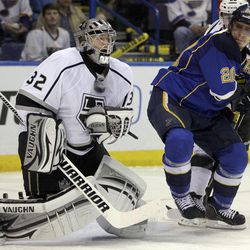 Los Angeles Kings goalie Jonathan Quick, left, makes a save in front of St. Louis Blues' Alexander Steen during the second period of Game 1 in a second-round NHL Stanley Cup hockey playoff series, Saturday, April 28, 2012, in St. Louis.