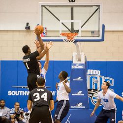 Andre shoots over Adams