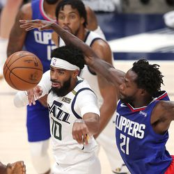 Utah Jazz guard Mike Conley (10) passes away from LA Clippers guard Patrick Beverley (21) as the Utah Jazz and LA Clippers play in an NBA basketball game at Vivint Smart Home Arena in Salt Lake City on Friday, Jan. 1, 2021. Utah won 106-100.