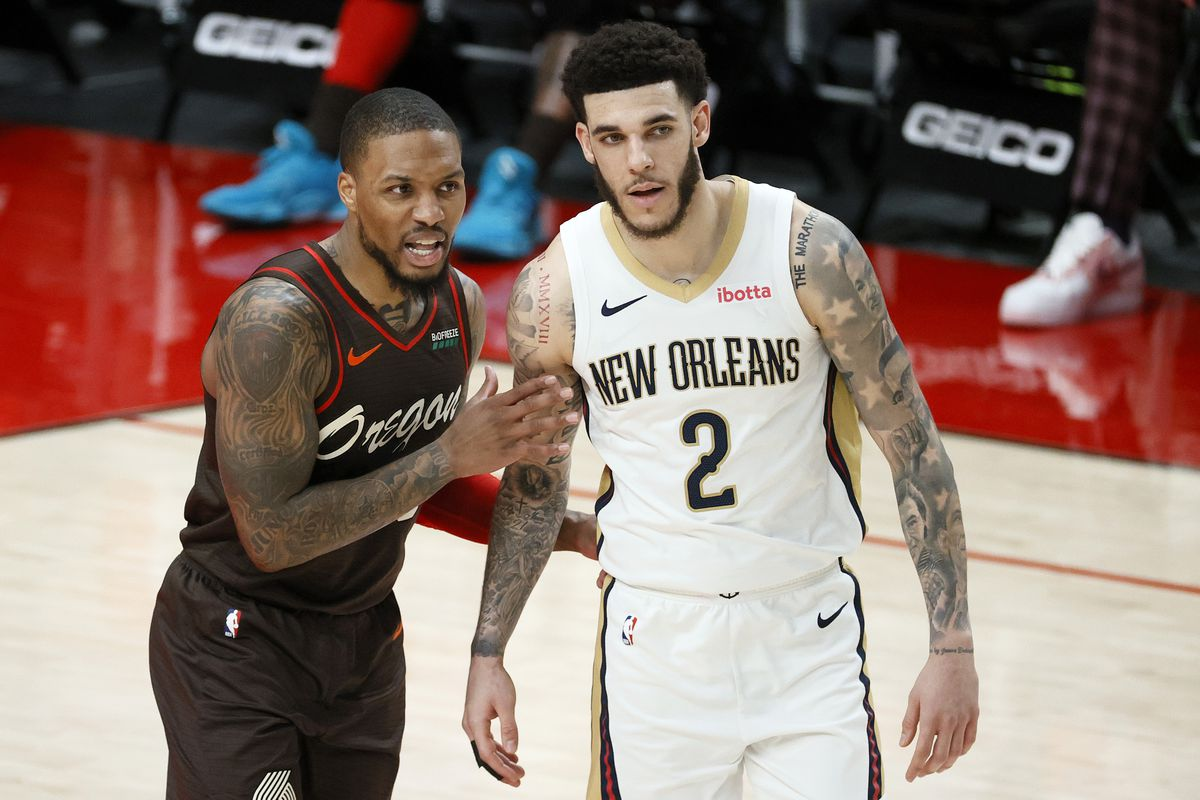 Damian Lillard of the Portland Trail Blazers defends Lonzo Ball of the New Orleans Pelicans during the third quarter at Moda Center on March 18, 2021 in Portland, Oregon.