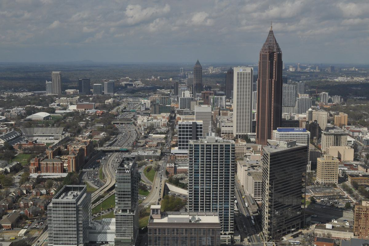 A photo of the Midtown and downtown Atlanta skylines.