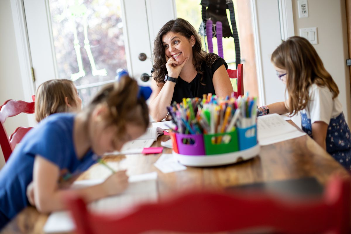 Melissa Seger does schoolwork with her daughters, twins Gwendolyn, left, and Vivian, 6, and Lydia, 10, at their home in South Jordan on Thursday, Oct. 7, 2021.