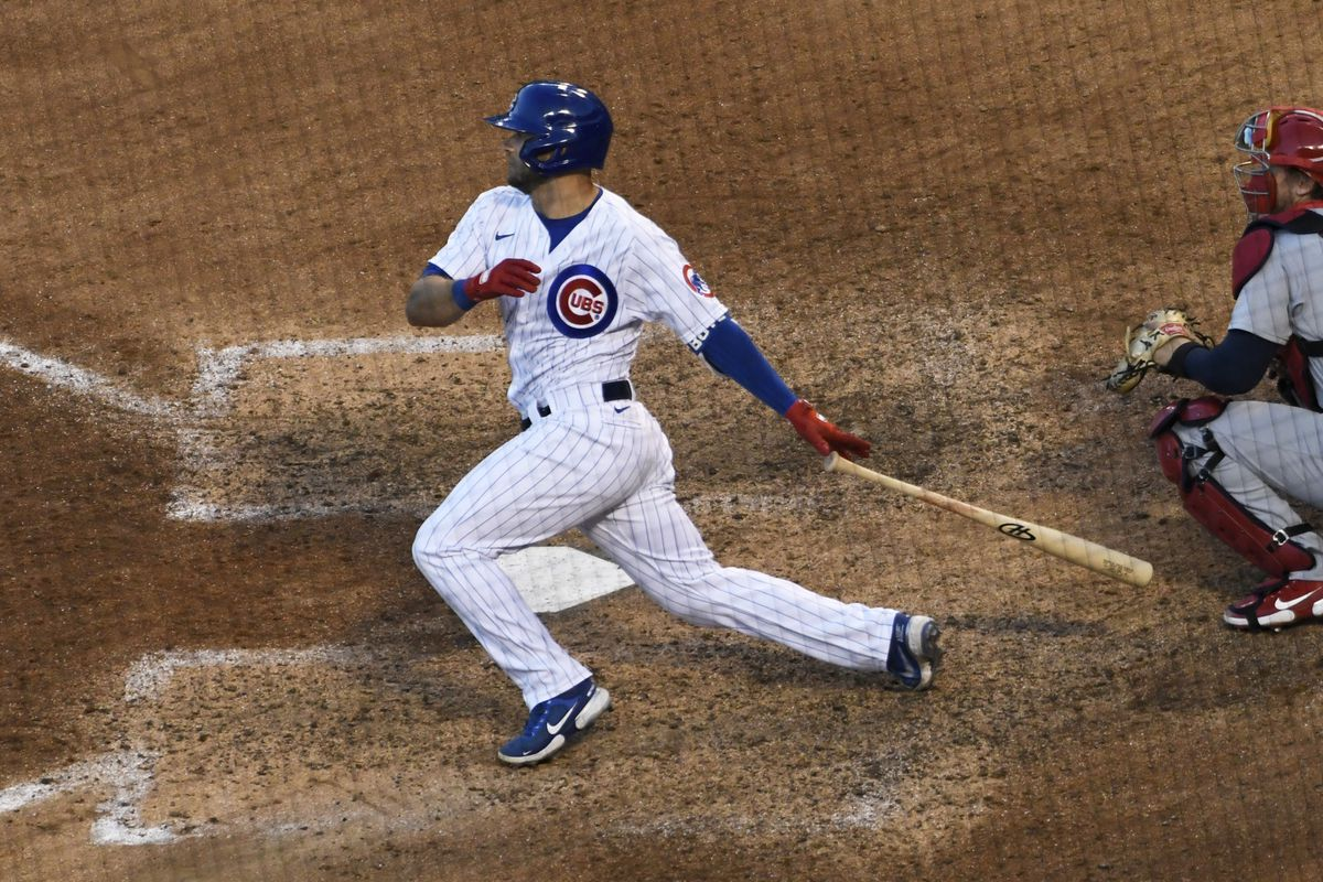 The Cubs' David Bote follows through on a two-run single against the Cardinals during the seventh inning of Game 2 Wednesday.