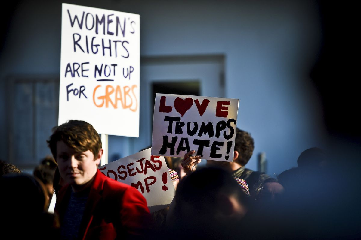 People hold placards during a march in central Lisbon on January 21, 2017 in a mark of solidarity for the political rally promoting the rights and equality for women, Women's March on Washington, taking place today in the US capital.