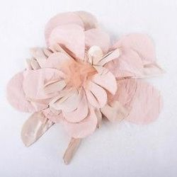 An Elisa Palomino pink floral hair accessory. Buy it now for $295. Photos: via Luxury Garage Sale