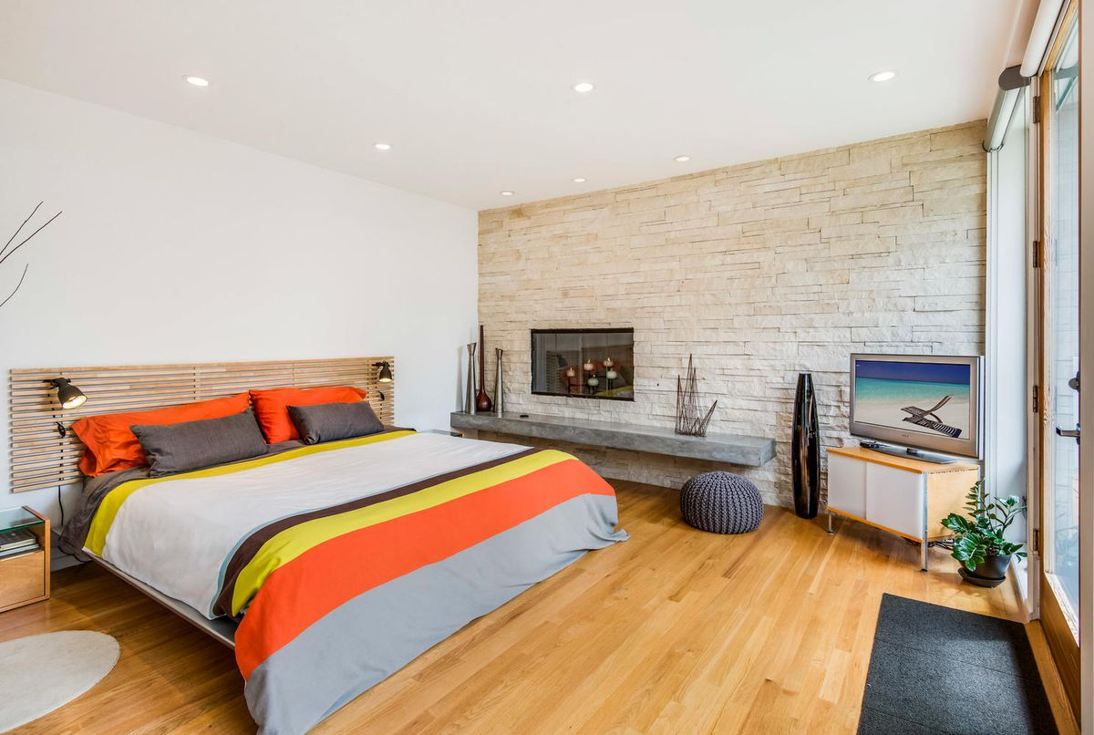 Bedroom with fireplace and outdoor access