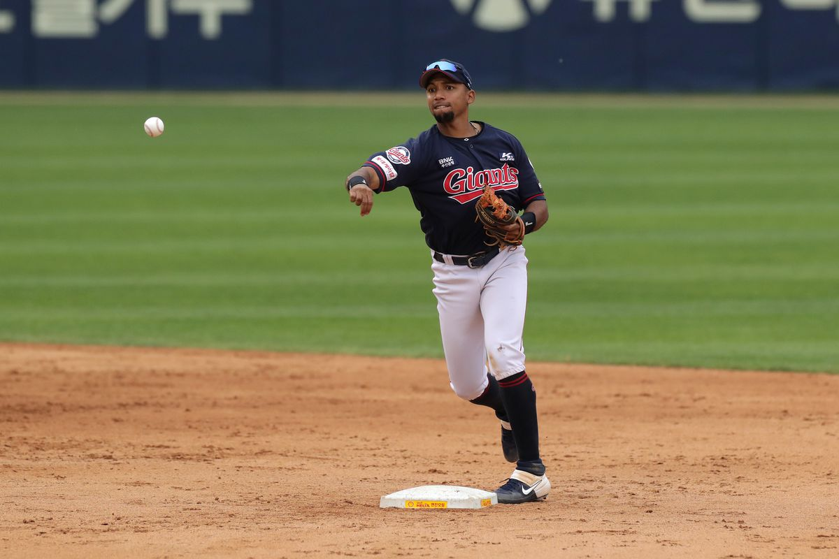 Infilder Machado Dixon of Lotte Giants catchse the ball in the the bottom of the tenth inning during the KBO League game between Lotte Giants and Doosan Bears at the Jamsil Stadium on May 31, 2020 in Seoul, South Korea.