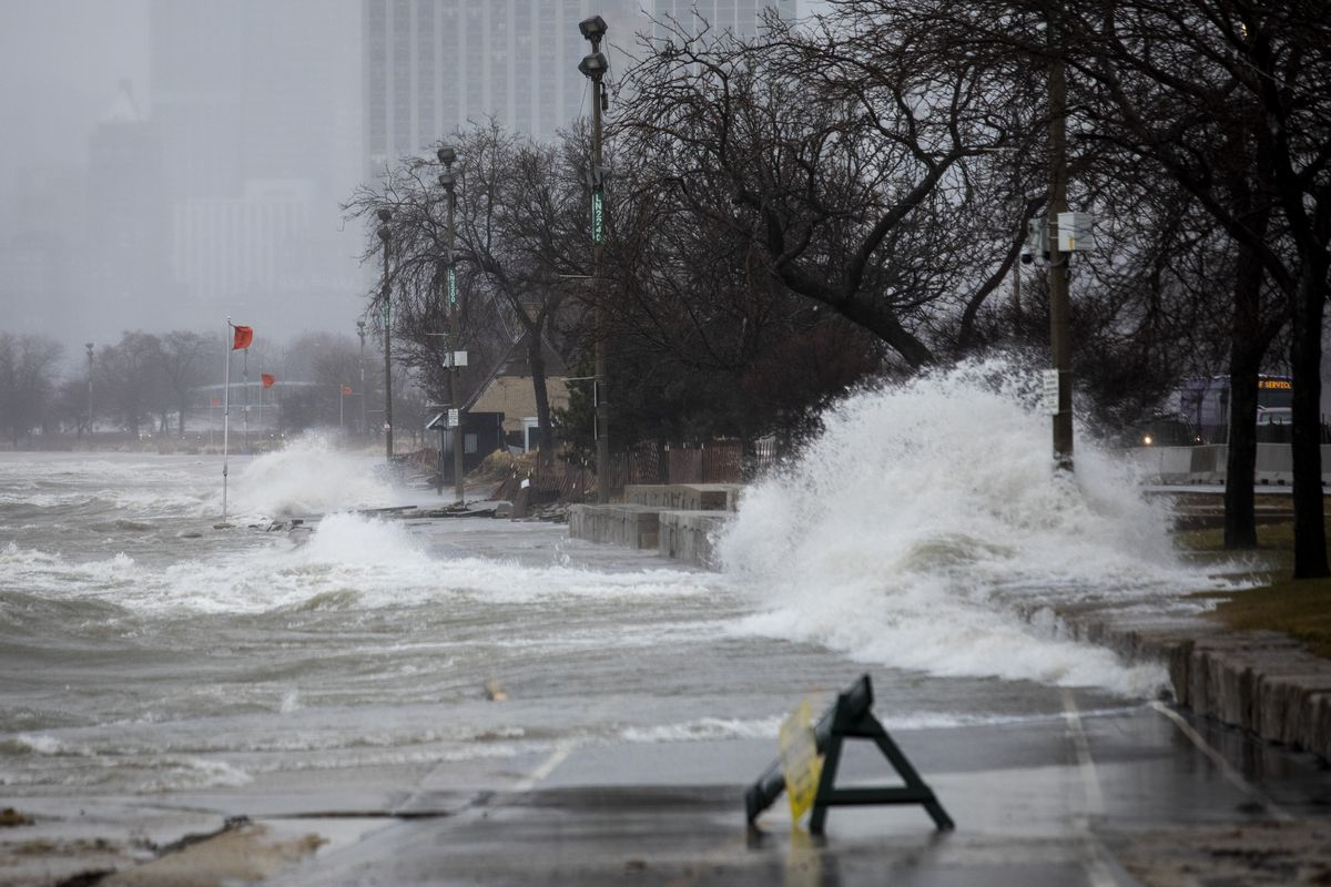 Waves close the lakefront trail near Fullerton Avenue last year, when Lake Michigan levels reached a record high.
