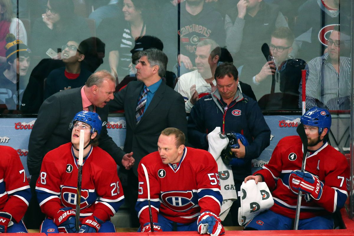 Mar 10, 2015; Montreal, Quebec, CAN; Montreal Canadiens head coach Michel Therrien talks to defenseman Andrei Markov (79) (right) and defensemen Sergei Gonchar (55) and Nathan Beaulieu (28) during the third period against Tampa Bay Lightning at Bell