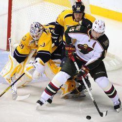 Minnesota Wild right wing Dany Heatley (15),  controls the puck in front of Nashville Predators defenseman Ryan Suter (20) and goalie Anders Lindback (39), of Sweden, during the second period of an NHL hockey game on Tuesday, April 3, 2012, in Nashville, Tenn.