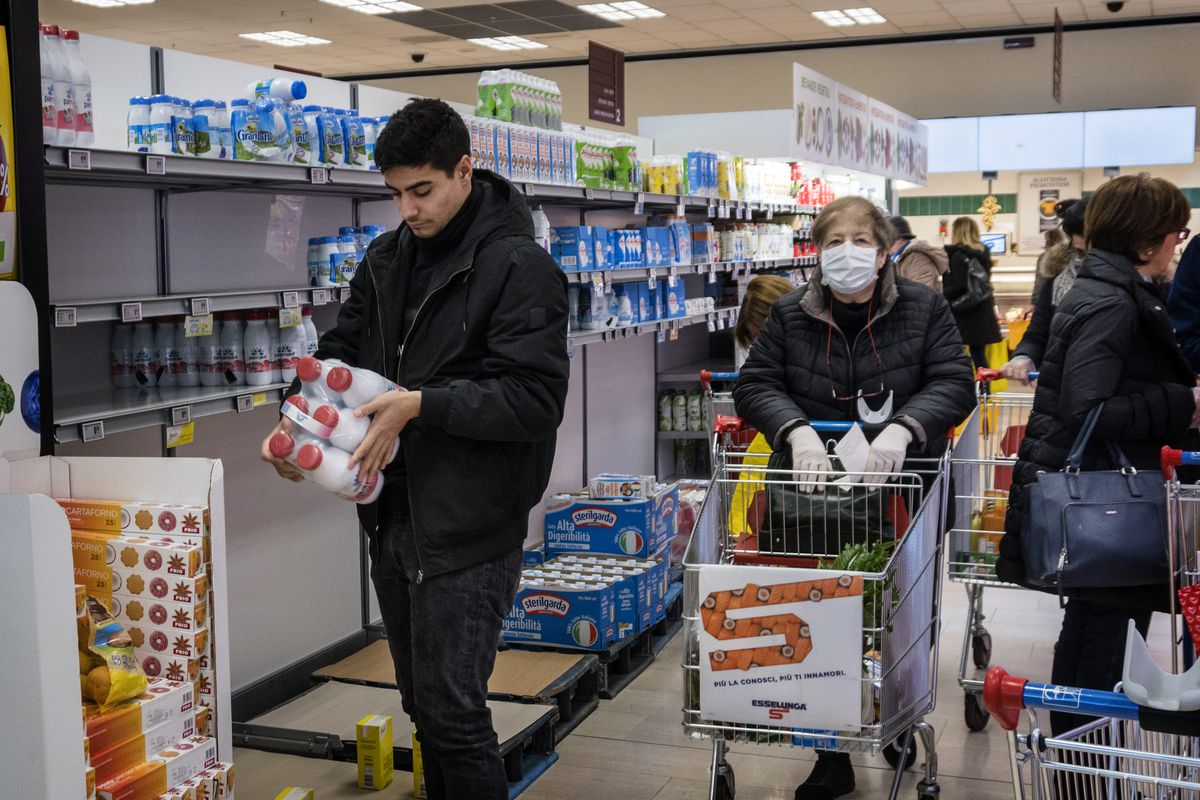 Shoppers stockpile items in a supermarket in Milan, Italy, due to the coronavirus threat.