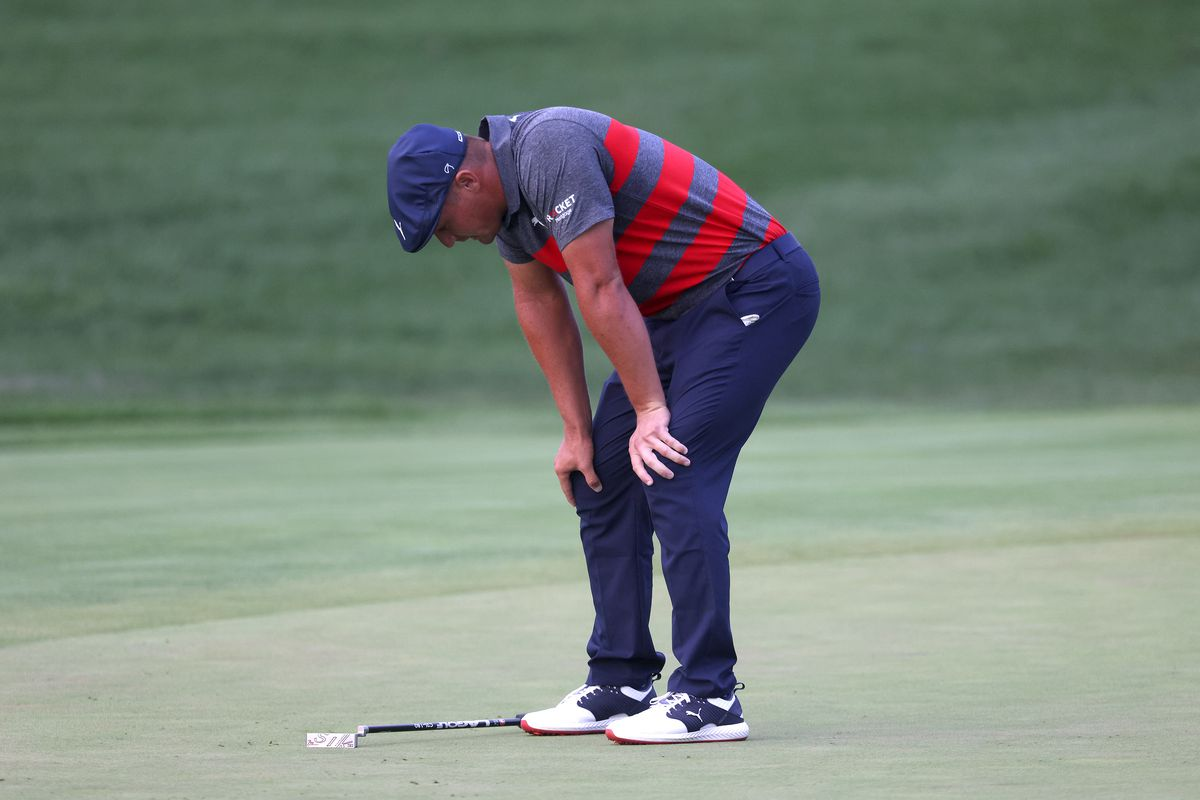 Bryson DeChambeau of the United States reacts to a missed putt on the 17th green during a playoff in the final round of the BMW Championship at Caves Valley Golf Club on August 29, 2021 in Owings Mills, Maryland.