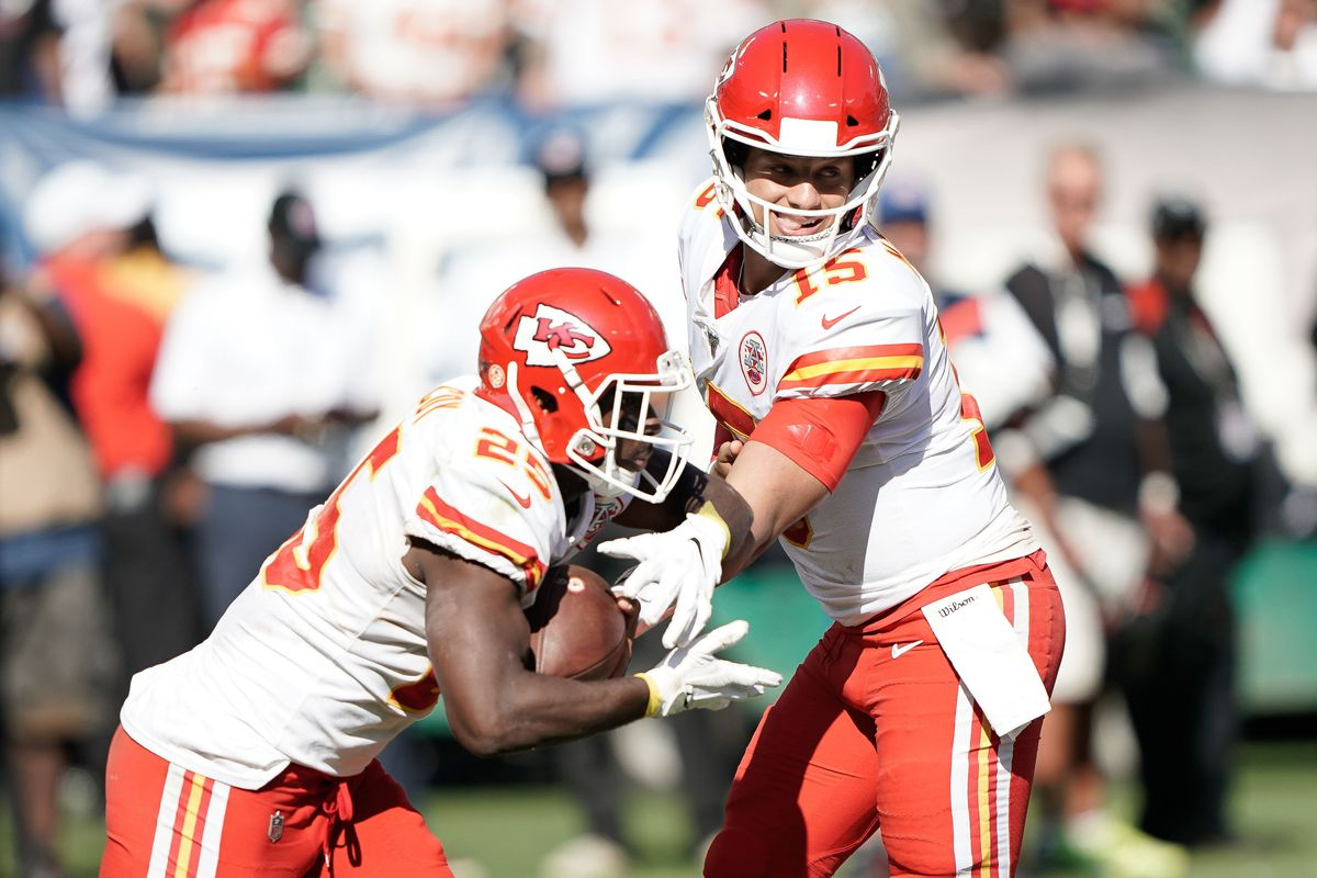 Kansas City Chiefs quarterback Patrick Mahomes (15) hands the ball off to running back LeSean McCoy (25) in the game against the Oakland Raiders during the fourth quarter at the Oakland Coliseum.