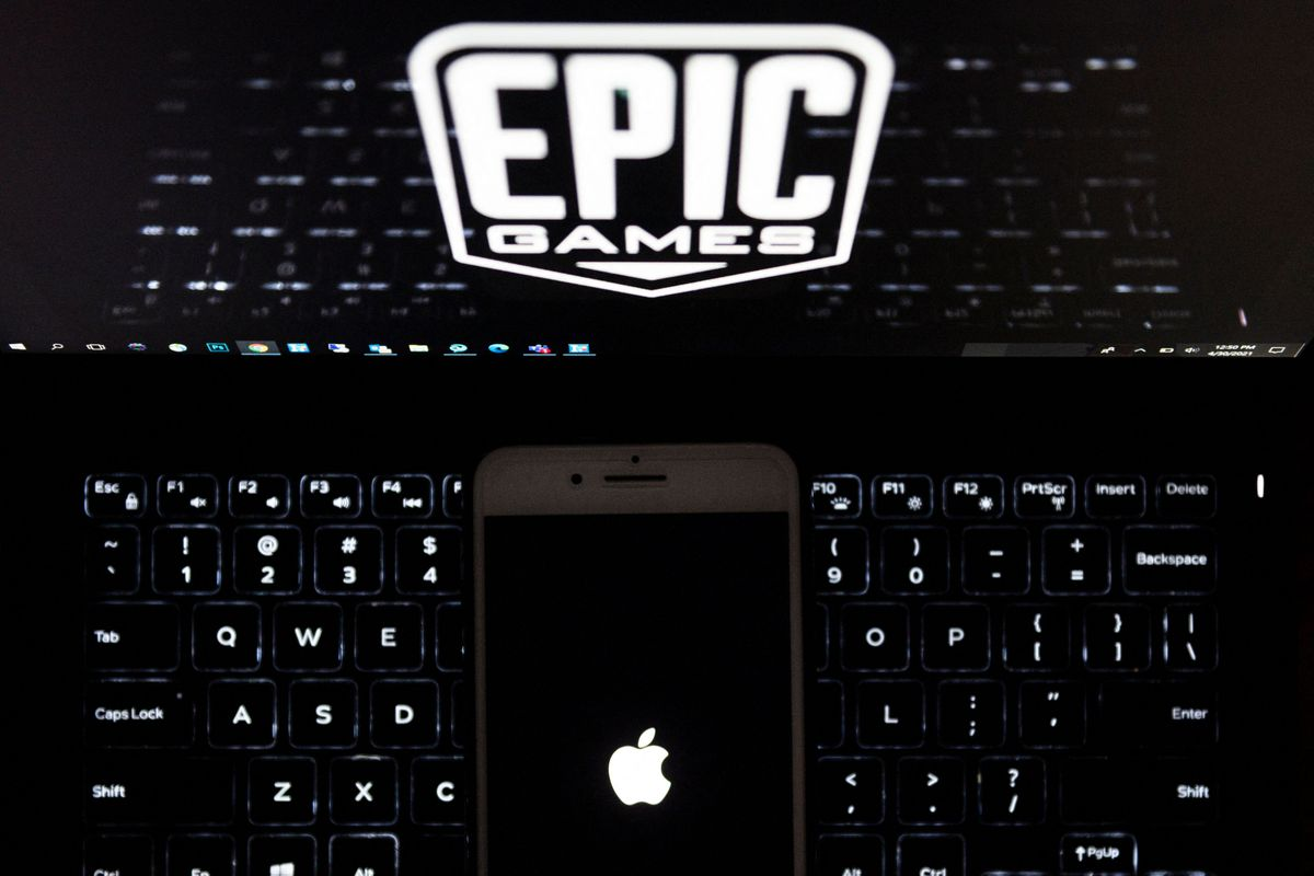 An iPhone sitting on a keyboard below the Epic Games logo.