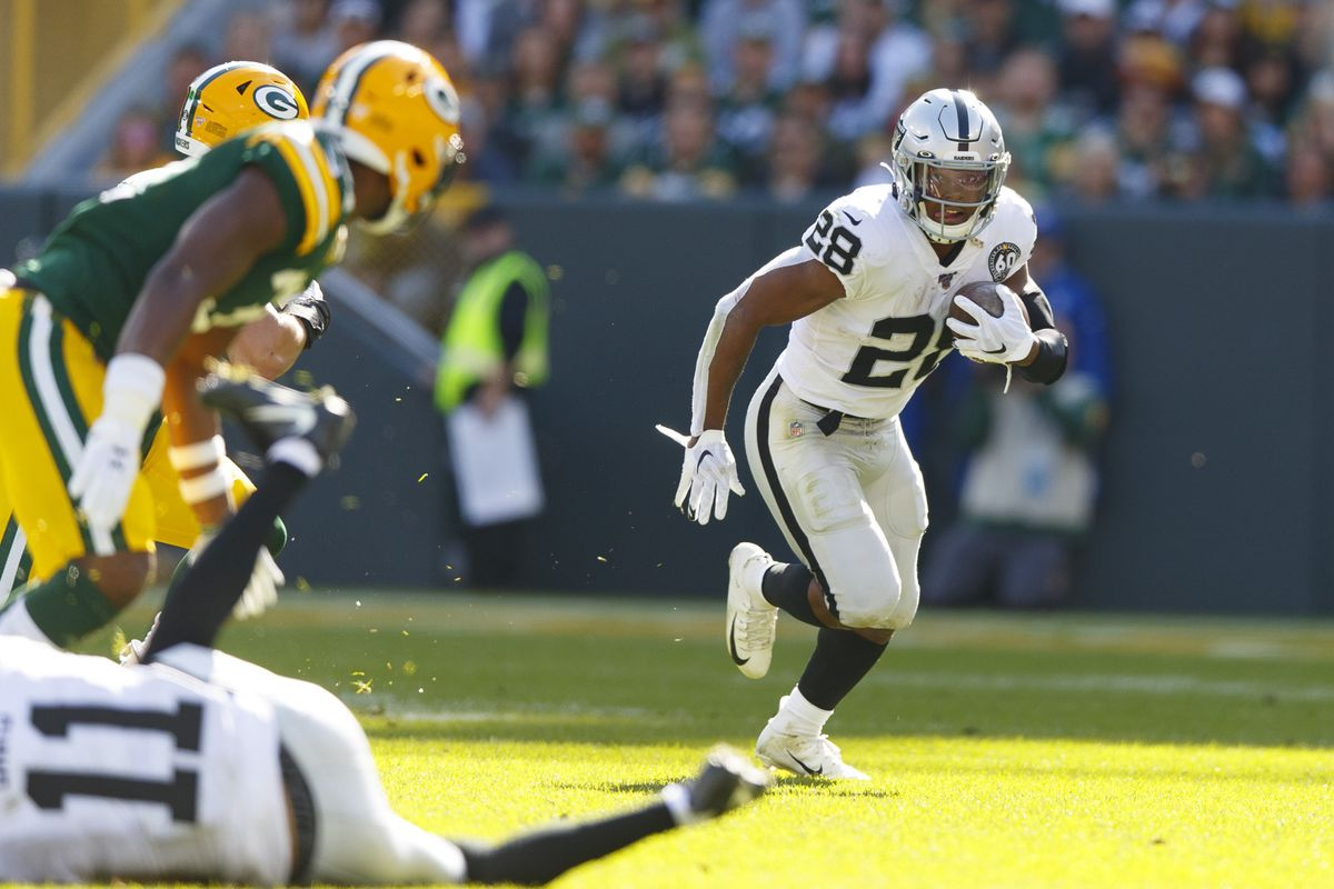Oakland Raiders running back Josh Jacobs rushes with the football during the first quarter against the Green Bay Packers at Lambeau Field.