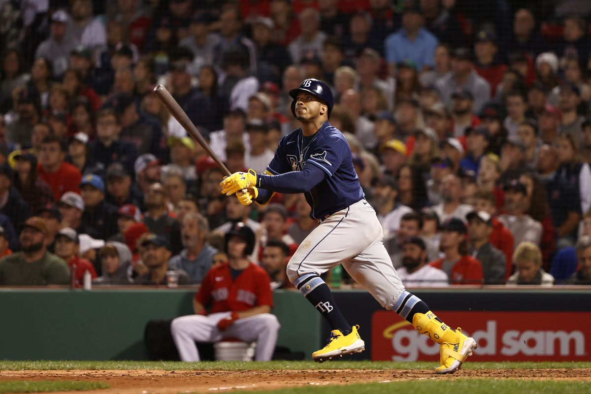 Wander Franco #5 of the Tampa Bay Rays hits a solo homerun in the eighth inning against the Boston Red Sox during Game 3 of the American League Division Series at Fenway Park on October 10, 2021 in Boston, Massachusetts.