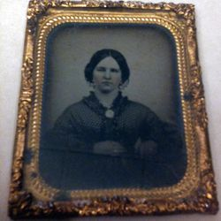 So many Daguerreotype photos (glass images) like this one Mrs. Stephen Harding, wife of Utah's Territorial Governor, in 1862.  Most photos never have identification on them because there was no place to write on the photo. Some people stuck a note inside the case that held the photo.