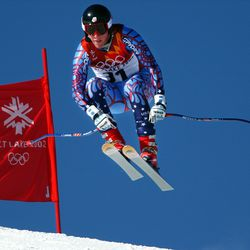 USA's Marco Sullivan goes airborne as he takes on the muzzleloader jump and skis to a ninth place in the men's downhill race at the Salt Lake 2002 Winter Olympic Games at Snowbasin on Feb. 10, 2002. Sullivan was the top U.S. finisher.