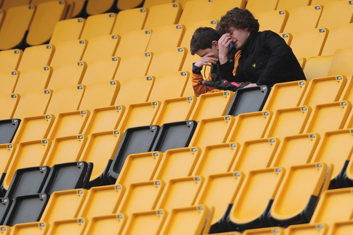 Dejection for fans of Wolves during the Barclays Premier League match between Wolverhampton Wanderers and Manchester City at Molineux .