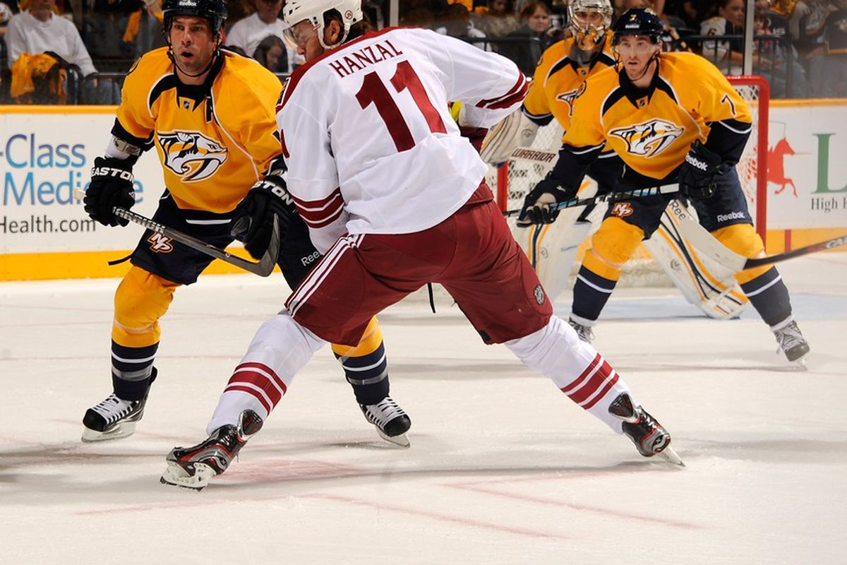 NASHVILLE, TN - OCTOBER 13:  Ray Whitney #13 of the Phoenix Coyotes takes a face off against David Legwand #11 of the Nashville Predators at the Bridgestone Arena on October 13, 2011 in Nashville, Tennessee.  (Photo by Frederick Breedon/Getty Images)
