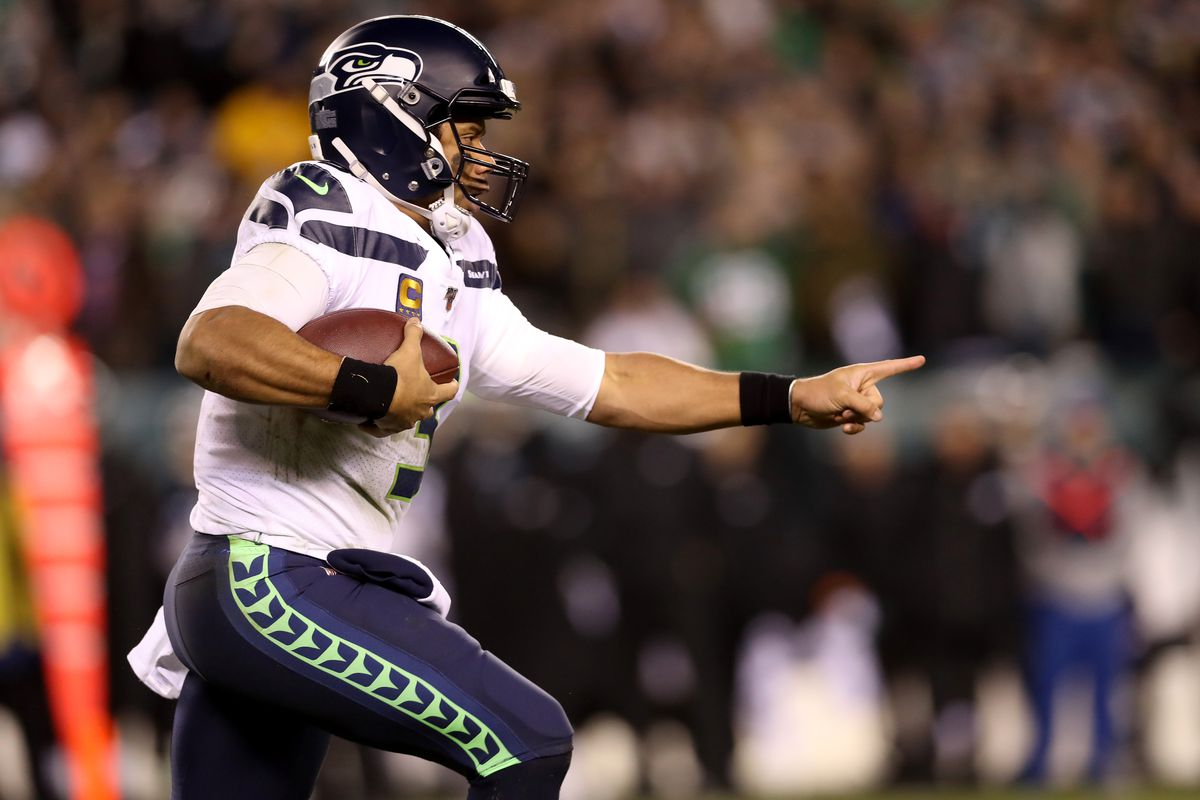 Quarterback Russell Wilson #3 of the Seattle Seahawks runs with the ball against the Philadelphia Eagles at Lincoln Financial Field on January 05, 2020 in Philadelphia, Pennsylvania.