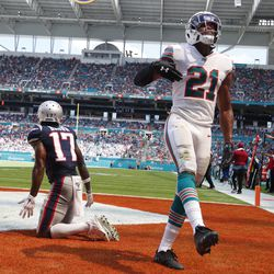 Miami Dolphins cornerback Eric Rowe (21) cheers after defending New England Patriots wide receiver Antonio Brown (17) in he end zone, during the second half at an NFL football game, Sunday, Sept. 15, 2019, in Miami Gardens, Fla.