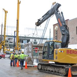 Brace being lowered into the excavation on Waveland