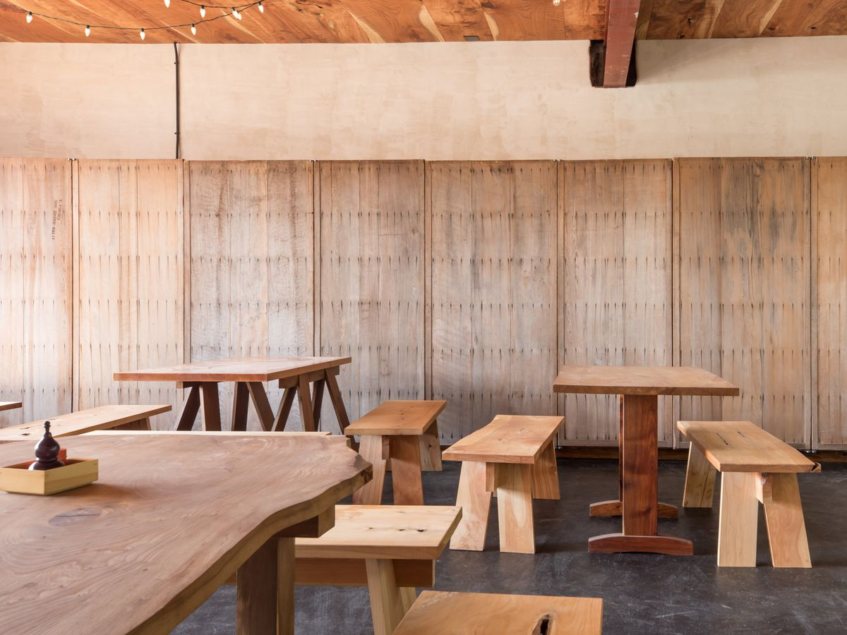 Interior shot of the table layout at Soba Ichi, with pale wood tables and benches