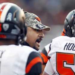 Oregon State Beavers defensive coordinator Kalani Sitake talks to players on the sideline during a Pac-12 football game versus the Utah Utes at Rice-Eccles Stadium in Salt Lake City, Saturday, Oct. 31, 2015.