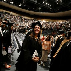 Graduates leave the Marriott Center after commencement exercises at Brigham Young University in Provo on Thursday, Aug. 13, 2015.