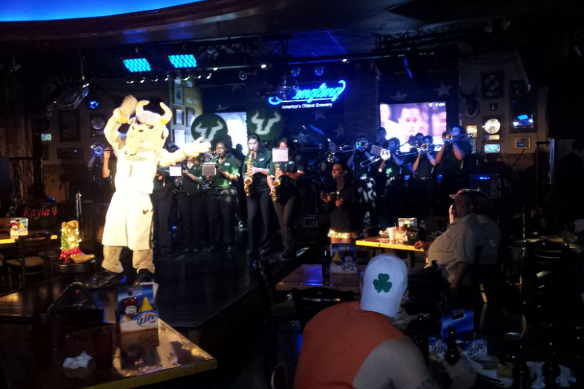 Rocky directing the band at the pre-game party at Cadillac Ranch in Nashville on Sunday. He was way too hip-hop to get a standing gig there, however.