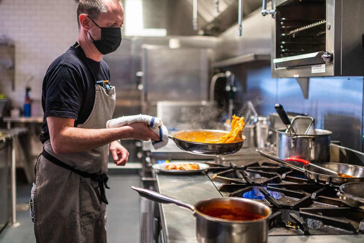Caruso's Grocery chef Matt Adler flips a pan full of pasta