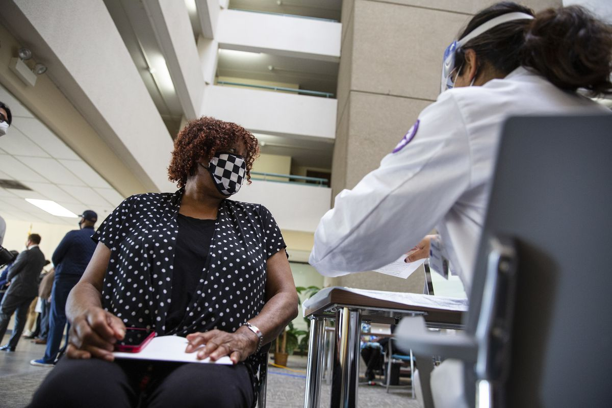 Eddie Mae Ferguson, 72, registers to get vaccinated Thursday, March 11, 2021 at the mobile vaccine program at Garden House Apartments, 515 S. 2nd Ave. in Maywood.