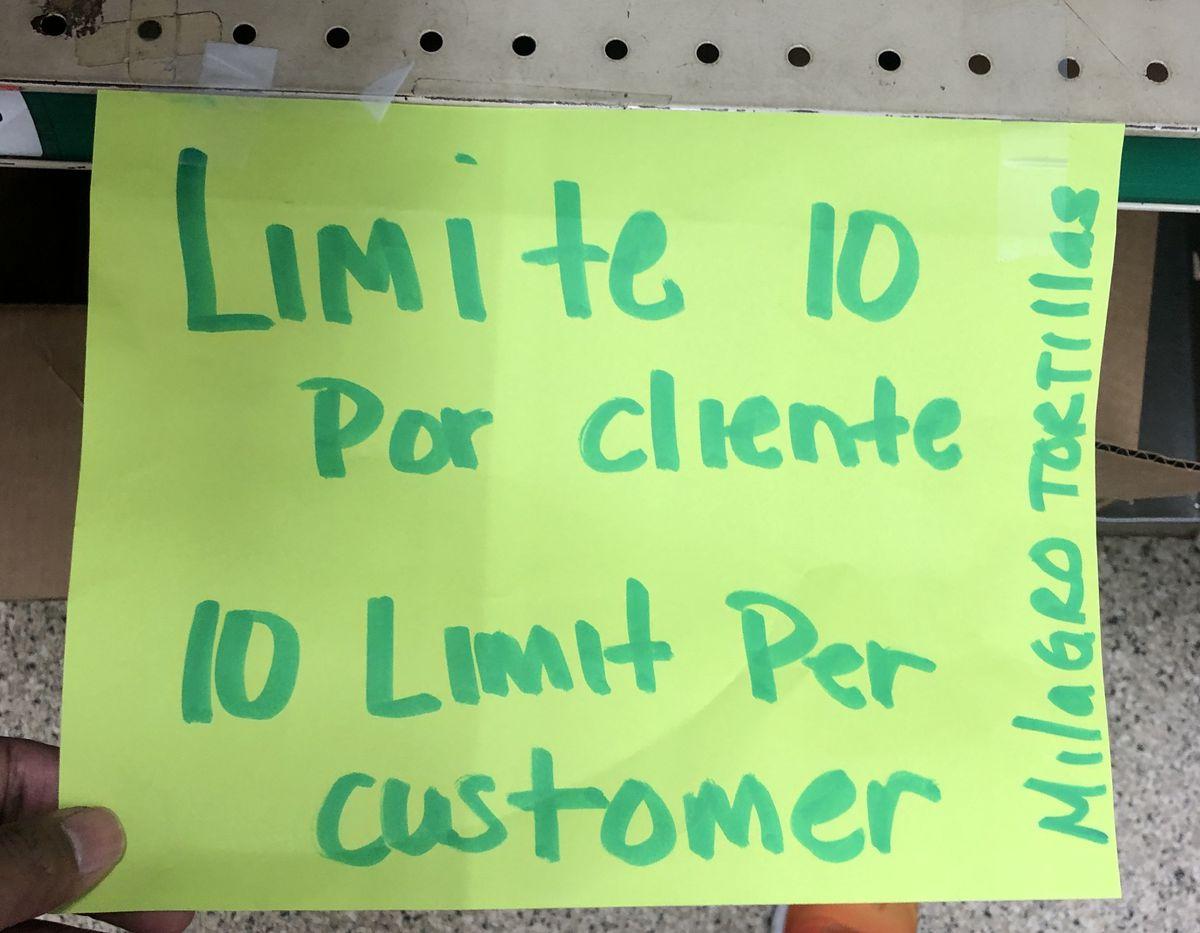 A handmade sign limiting tortillas.