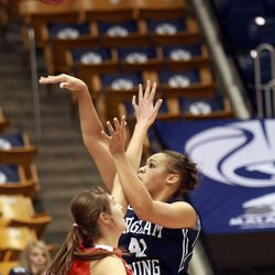 Utah's Emily Potter guards BYU's Morgan Bailey as she shoots during a women's basketball game at the Marriott Center in Provo on Saturday, Dec. 14, 2013. Utah won in double overtime 82-74.