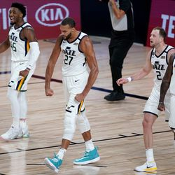 Utah Jazz's Rudy Gobert (27) celebrates a defensive stop with teammates Royce O'Neale (23), Joe Ingles (2) and Donovan Mitchell (45) during the first half of an NBA basketball first round playoff game against the Denver Nuggets, Monday, Aug. 3, 2020, in Lake Buena Vista, Fla.