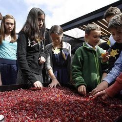 """Seventh-graders from the McGillis School look at an artistic interpretation of Kristallnacht, or """"Night of Broken Glass"""" before attending a Utah Holocaust Memorial Commemoration at the Jewish Community Center in Salt Lake City, Thursday, April 19, 2012."""