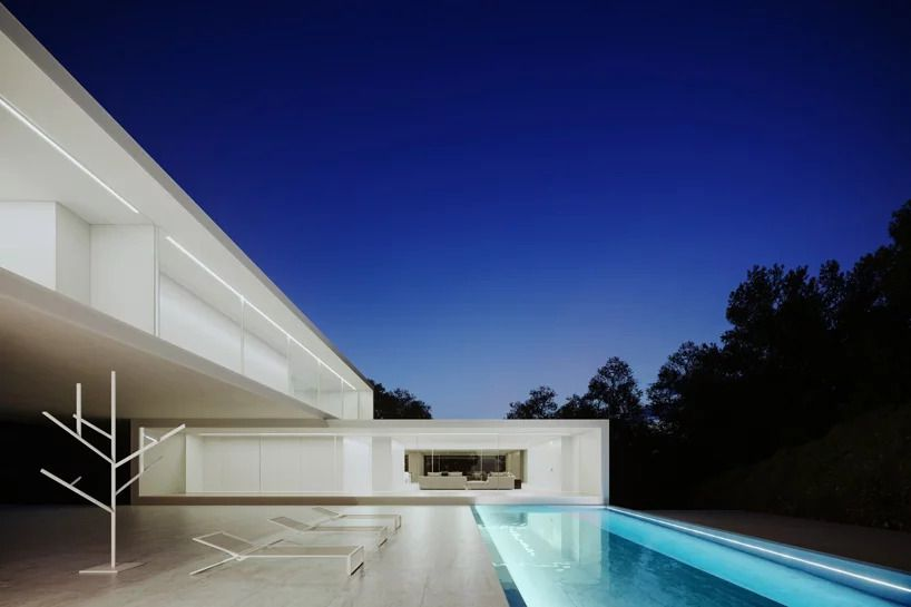Back patio with infinity pool.
