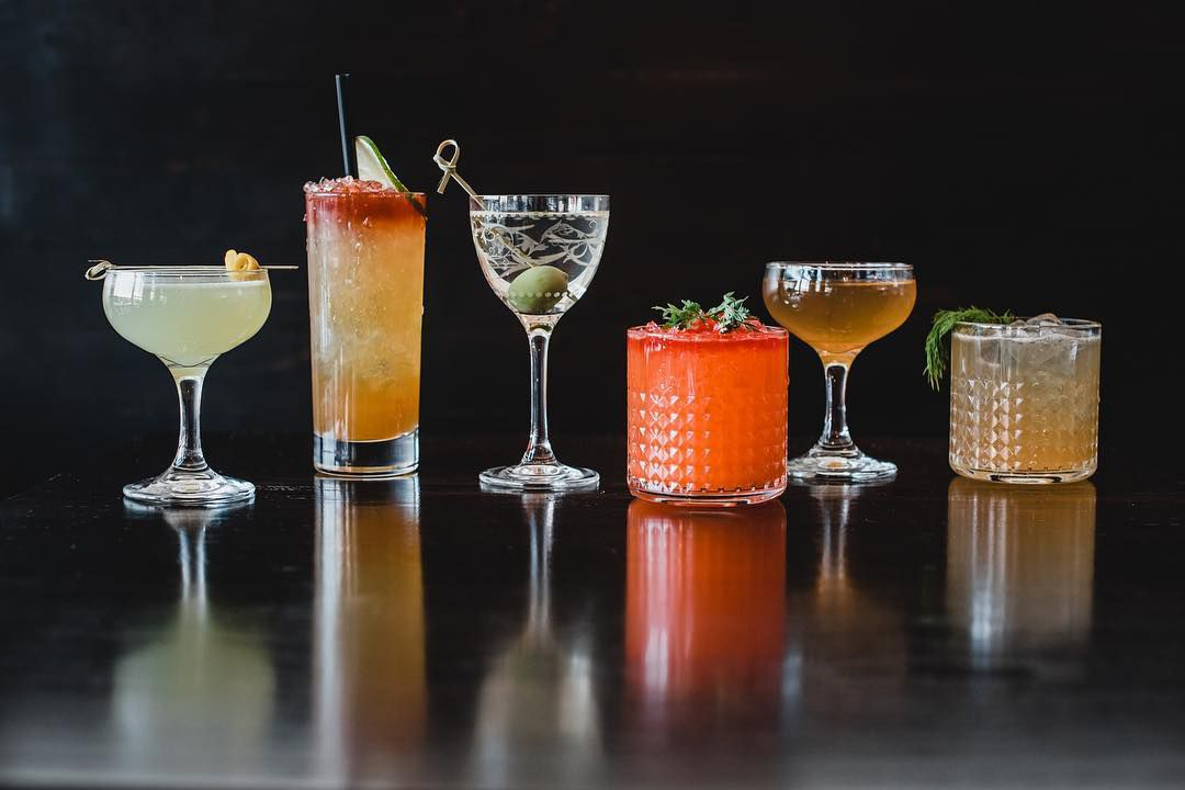 A lineup of six colorful cocktails