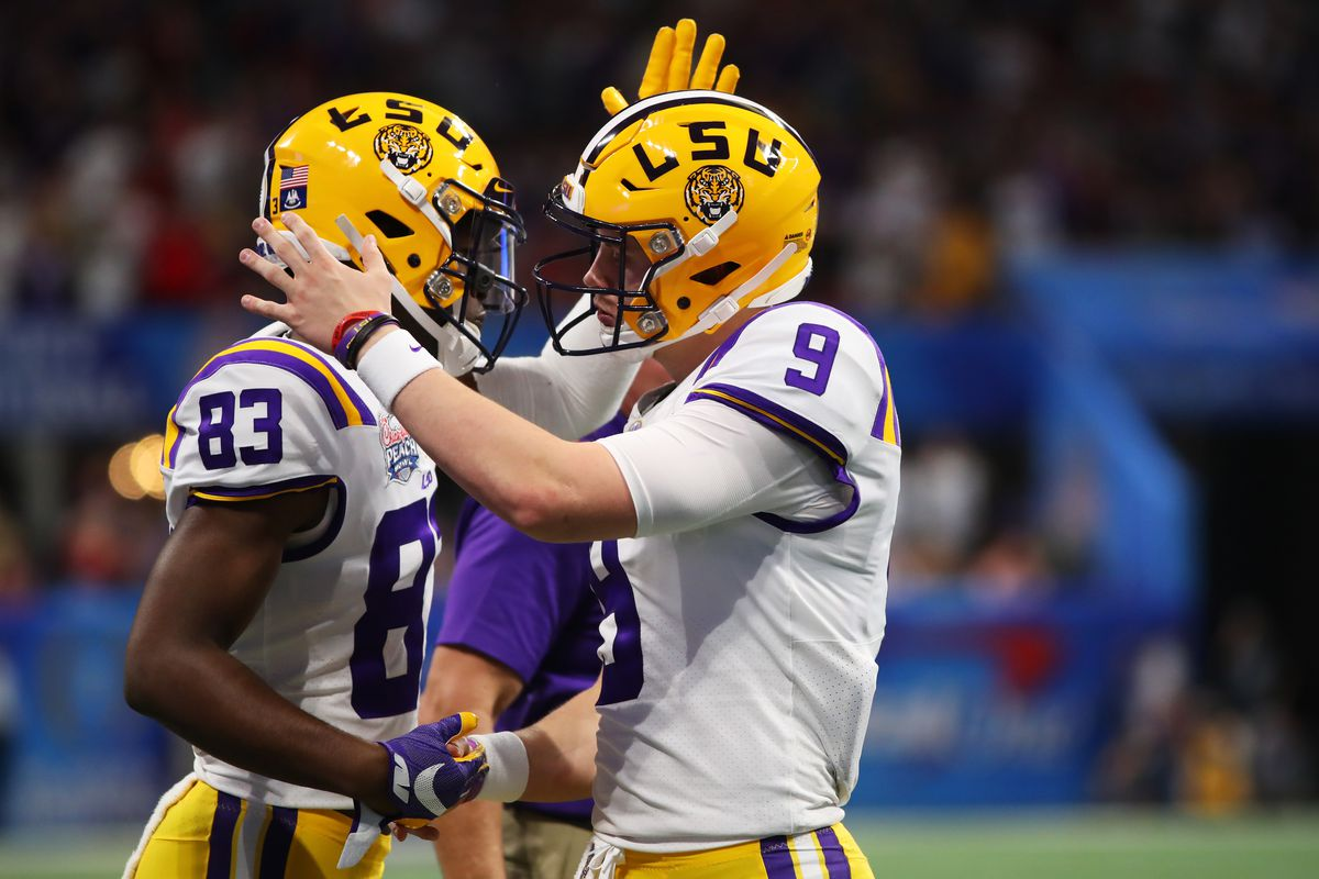 Quarterback Joe Burrow of the LSU Tigers and wide receiver Jaray Jenkins celebrate a touchdown in the first quarter of the game against the Oklahoma Sooners in the Chick-fil-A Peach Bowl at Mercedes-Benz Stadium on December 28, 2019 in Atlanta, Georgia.