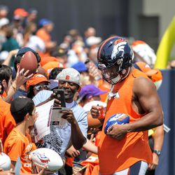 Broncos rookie OLB Bradley Chubb did not want to take his helmet off and reveal his new haircut, but still signed autographs after practice.