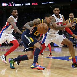 Utah Jazz guard Jordan Clarkson (00) drives to the basket against Detroit Pistons forward Christian Wood (35) with Pistons guard Jordan McRae (52) and Jazz center Rudy Gobert (27) following the play during the second half of an NBA basketball game Saturday, March 7, 2020, in Detroit.