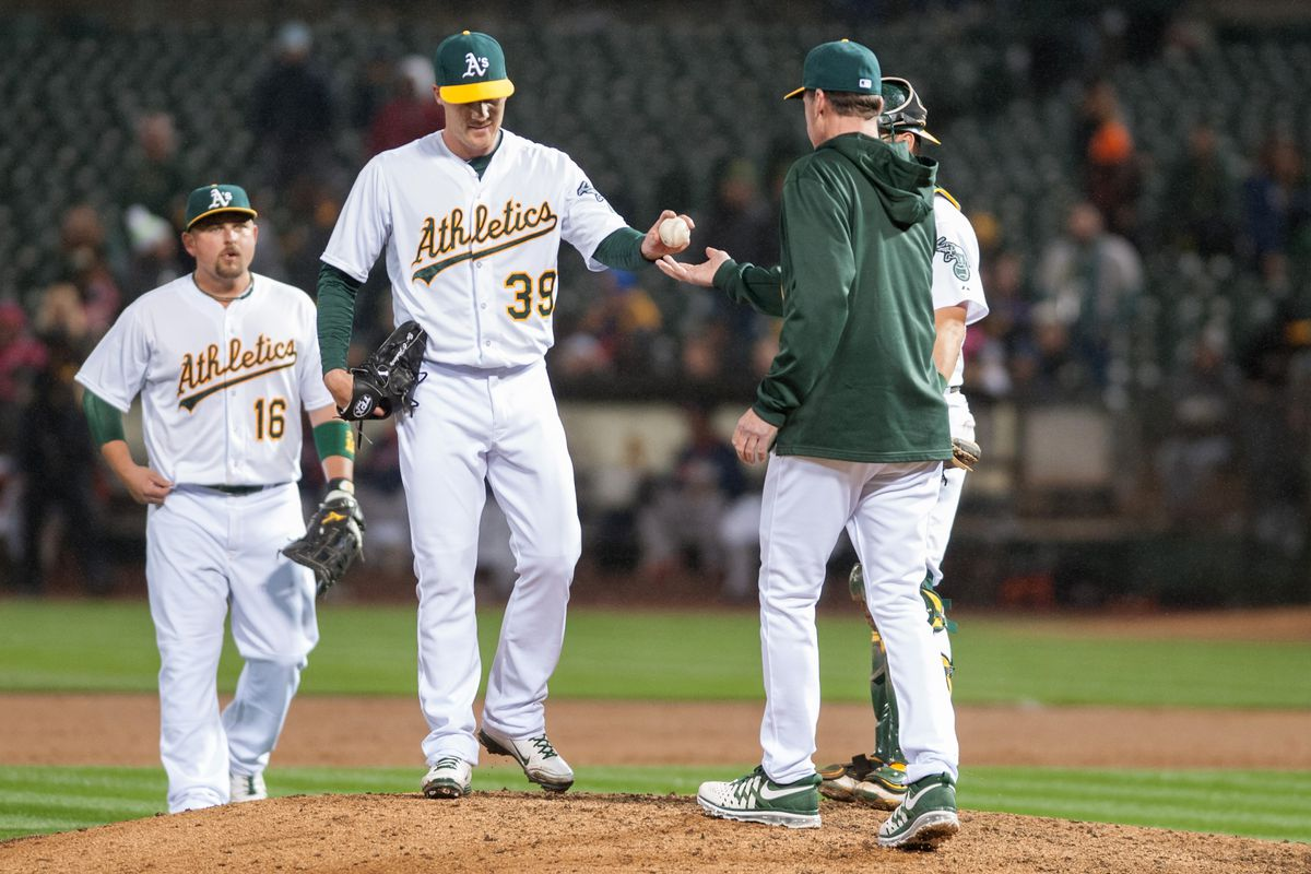 Eric O'Flaherty hands the ball to manager Bob Melvin.