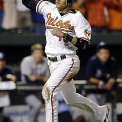 Baltimore Orioles' Manny Machado reacts as he scores on a single by Nate McLouth in the ninth inning of a baseball game against the Tampa Bay Rays in Baltimore, Wednesday, Sept. 12, 2012. Baltimore won 3-2.
