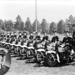 Salt Lake City's motorcycle police patrol in the late 1930's and the city's police chief inset at the left.