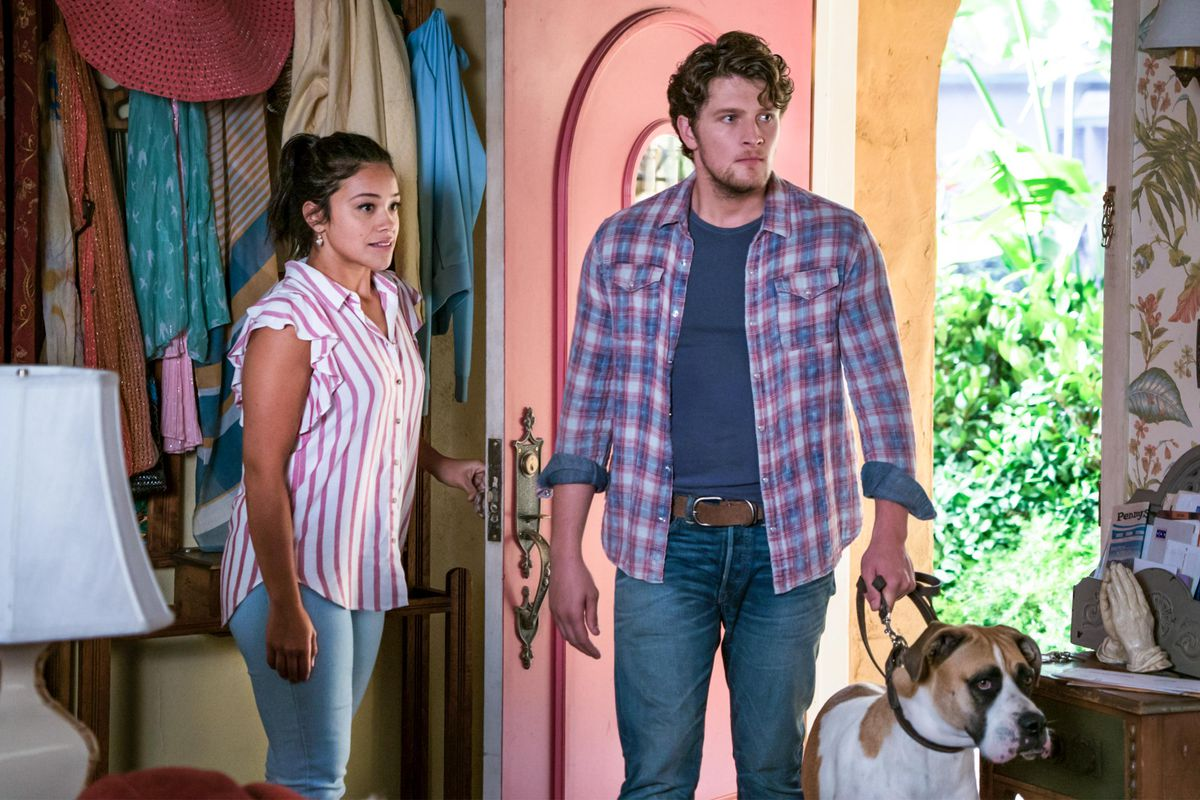 jane the virgin and a guy stand in the door