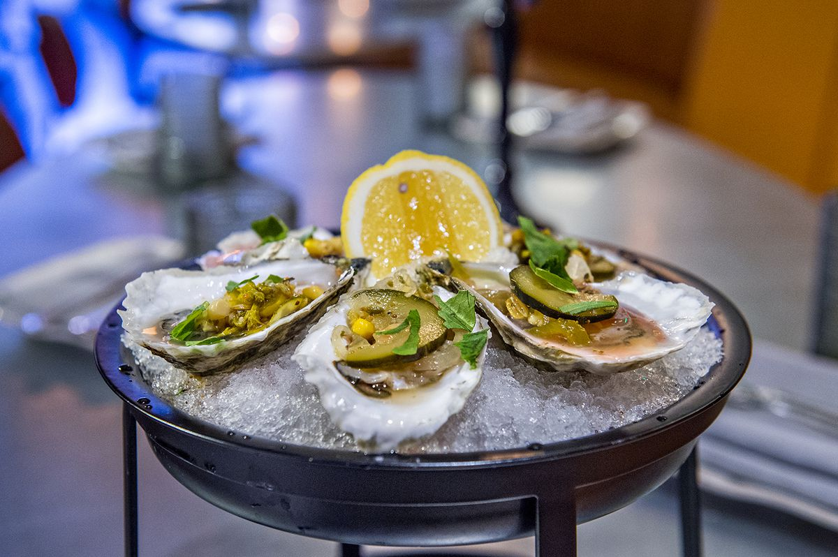 Oysters with mignonette and lemon on ice