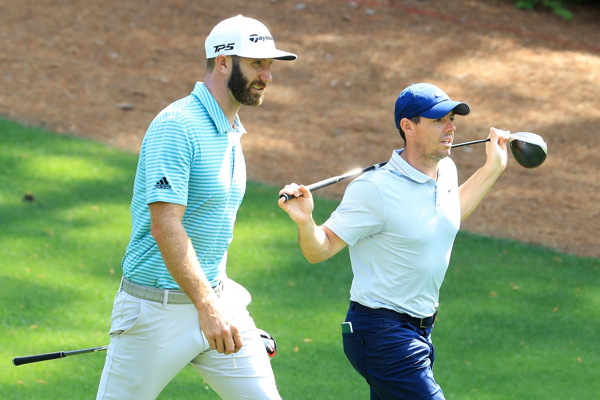 Rory McIlroy of Northern Ireland and Dustin Johnson of the United States walk during a practice round prior to The Masters at Augusta National Golf Club on April 08, 2019 in Augusta, Georgia.